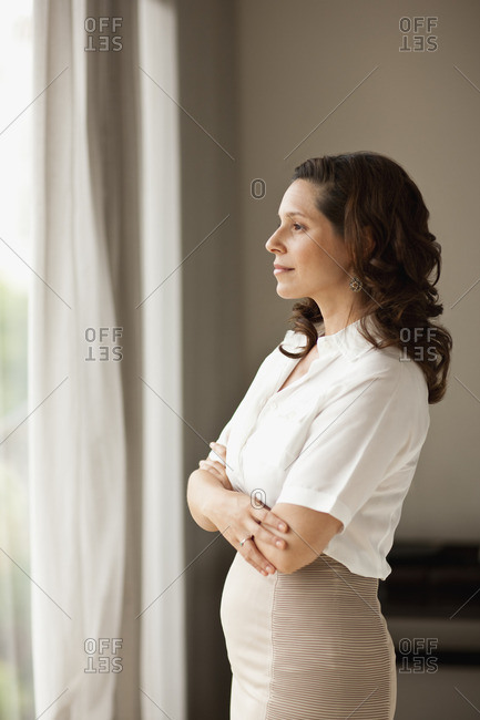 Businesswoman looking out of the window.