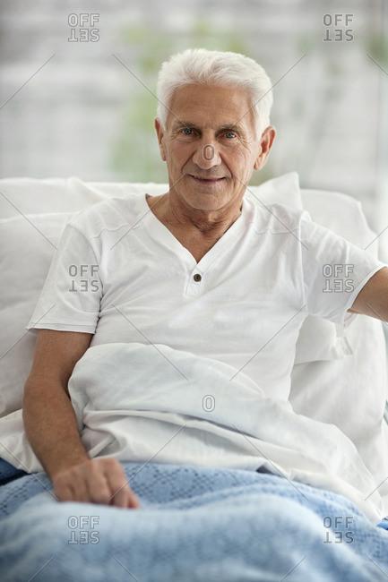 Senior man in bed.