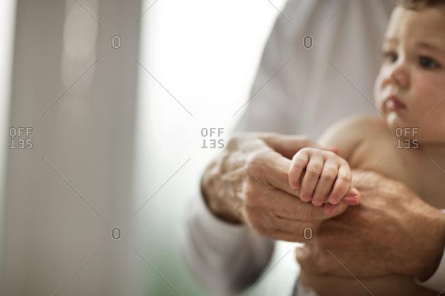Grandmother holding her baby grandchild.