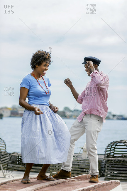 Couple dancing on a pier.