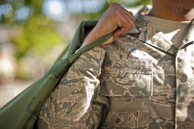 Soldier carrying his bag.