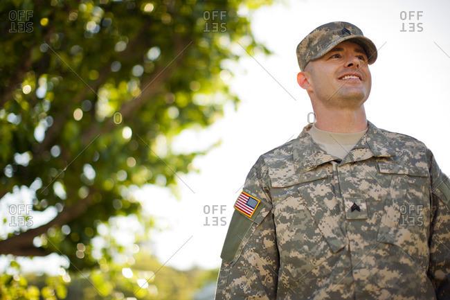 Smiling soldier in uniform.