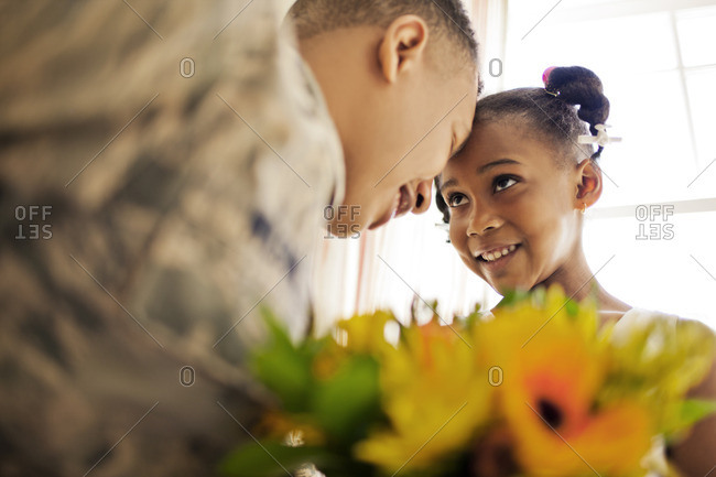 Soldier and his daughter after his homecoming.