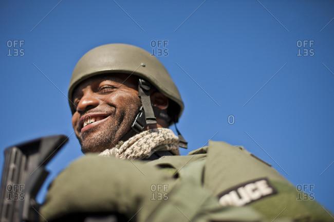 Smiling military policeman.