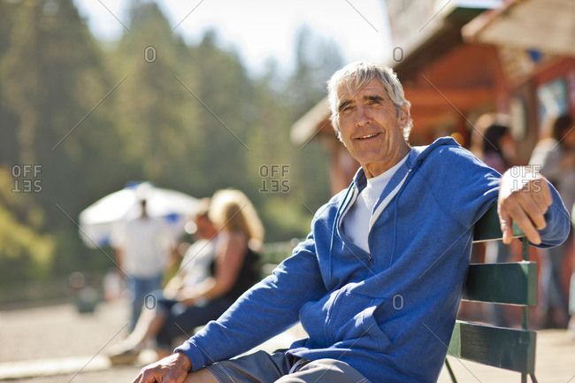 Senior man sitting on a bench.