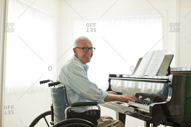 Senior man playing the piano.