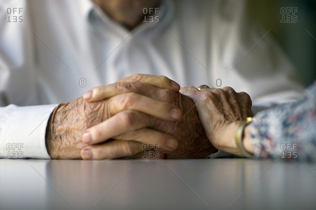 Hands of a senior couple.