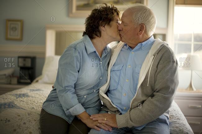 Senior couple sharing a kiss.