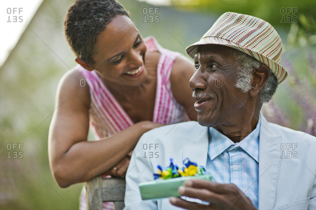 Senior Man Receiving A Birthday Gift From His Daughter Seniors Stock Photos Offset
