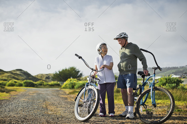 Senior couple bike riding in the countryside.