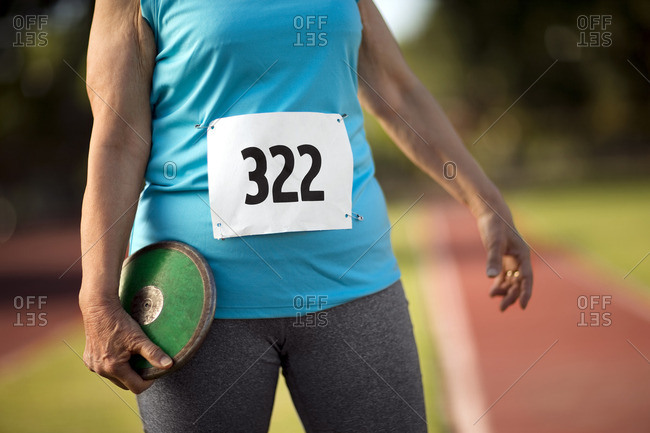 Woman in an athletics event holding a discus.