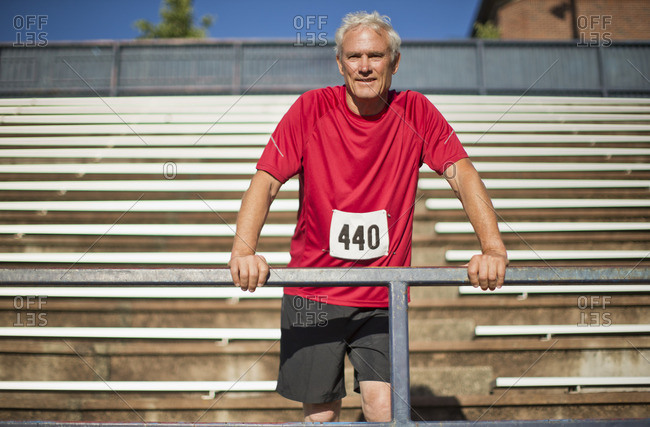 Senior competitor in a sports event watching from the stands.