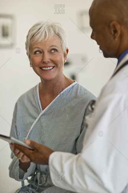 Patient smiling at her doctor during a medical check.