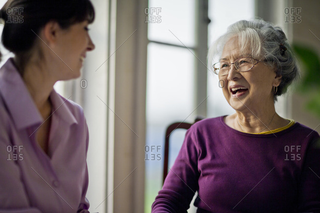 Senior woman laughing with a friend.