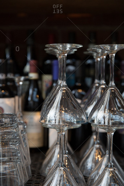 Group of clean cocktail glasses stacked upside down