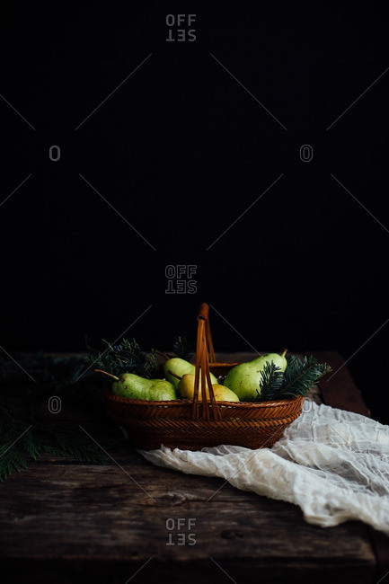 Still life with a basket full of d'anjou pears