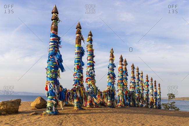 Shaman wooden pillars with colored cloth on Olkhon island. Irkutsk, South Siberia, Russia