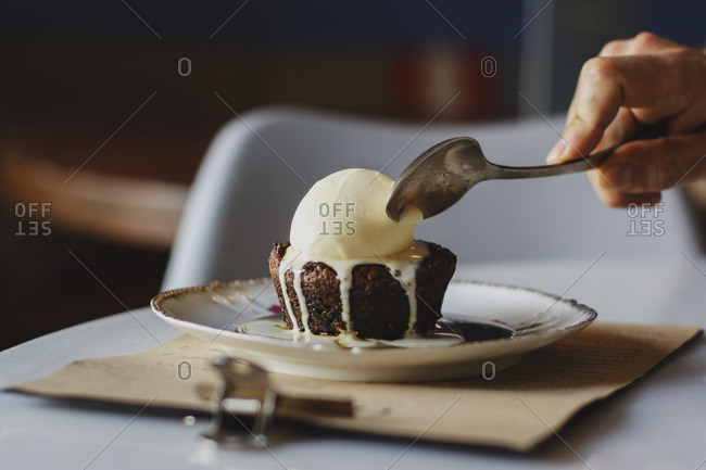Small chocolate cake served with vanilla ice cream