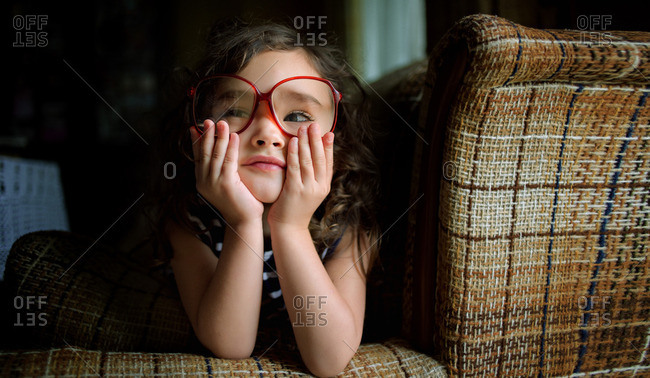 Little girl wearing large red glasses