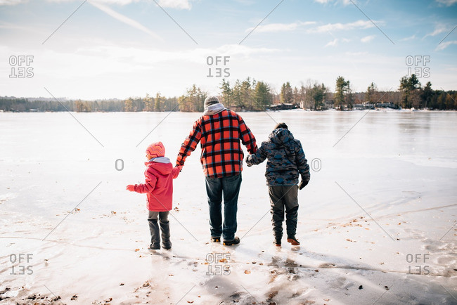 Family walking together on an icy lake