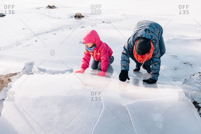 Children playing on an icy lake