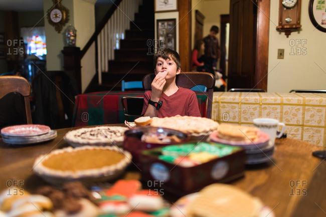 Boy eating dessert at a holiday dinner