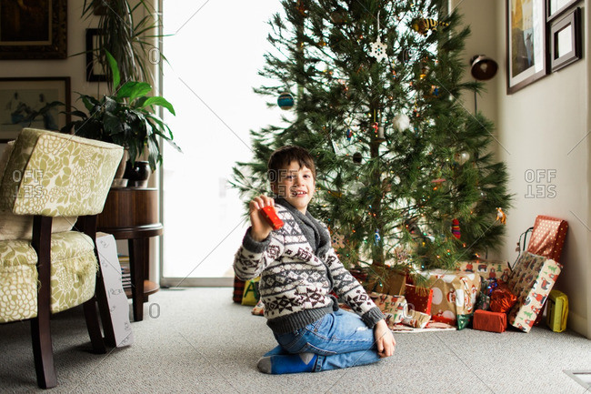 Happy boy holding small Christmas present