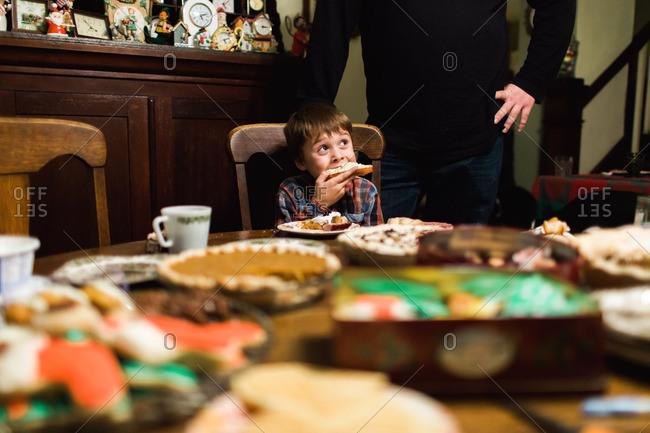 Little boy eating dessert at a holiday dinner