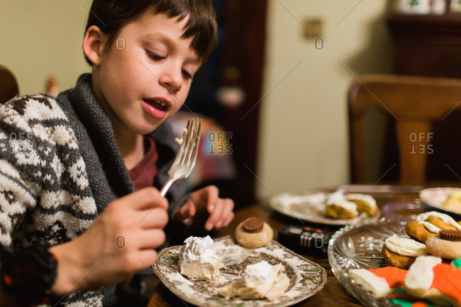 Young boy eating dessert at a holiday dinner