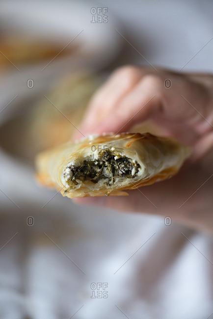 Eating Greek spanakopita