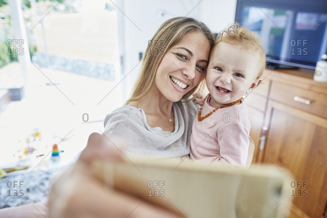 Happy mother with baby girl taking a selfie