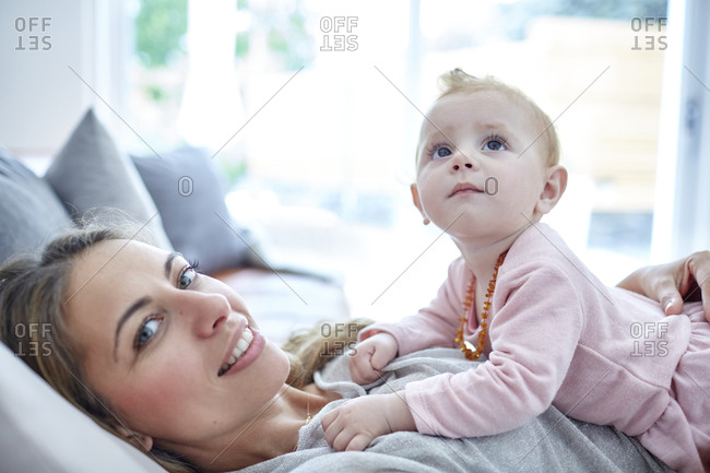 Mother and baby girl relaxing at home