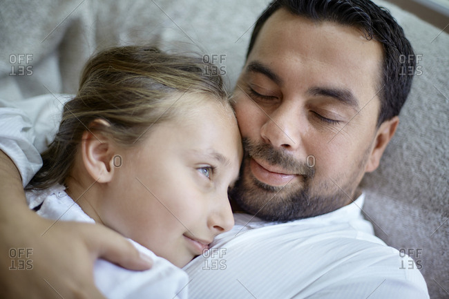 Father and daughter hugging at home