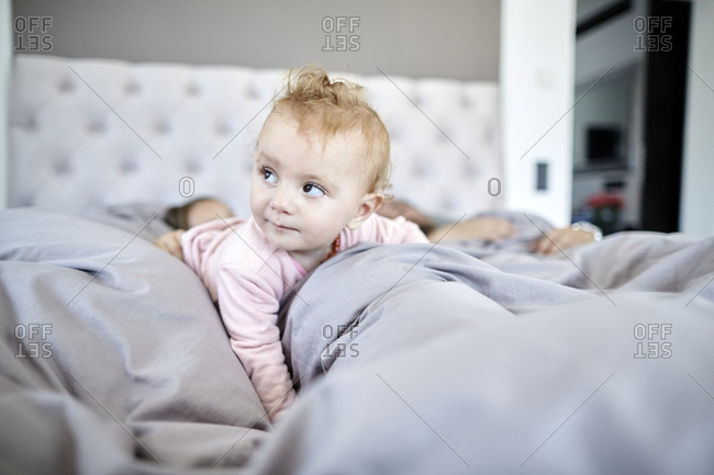 Baby girl lying in bed