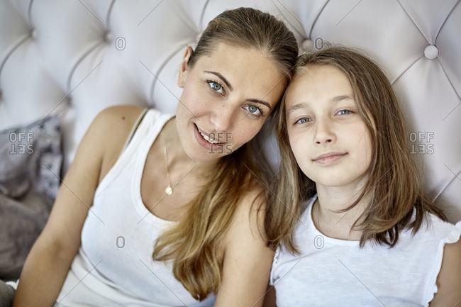 Portrait of mother and daughter in bed