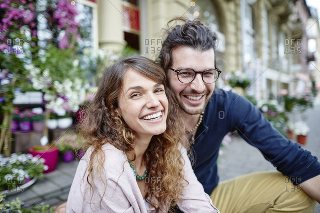 Portrait of happy young couple in the city