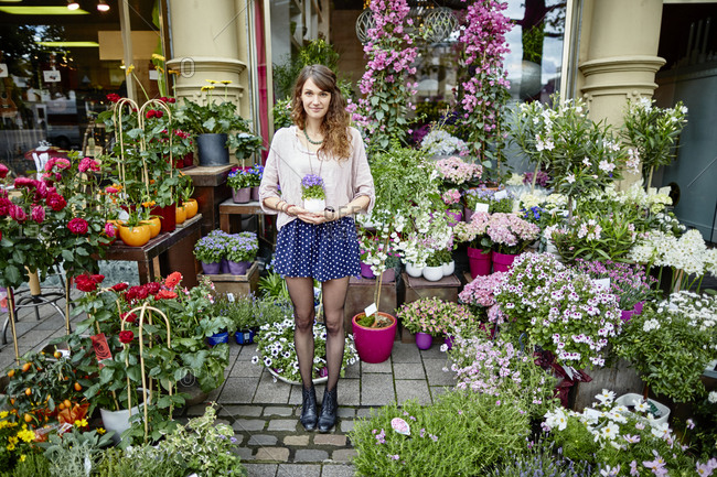 Young woman standing at flower shop