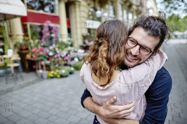 Happy young couple hugging in the city