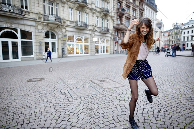 Happy young woman in the city