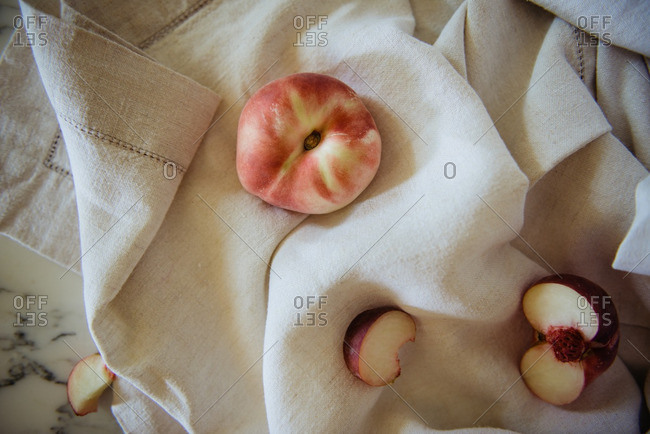 White peaches on linen