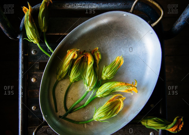 Squash blossoms in roasting pan