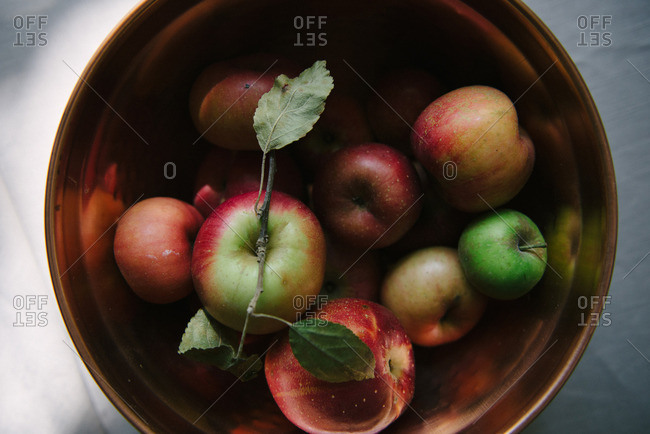 Apples in copper bowl
