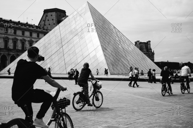 Paris, France - May 21, 2016: Cycling and Photographing at the Louvre