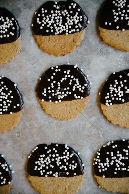 Gluten-free sugar cookies dipped in dark chocolate ganache