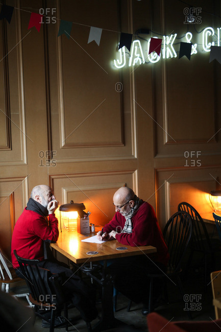 Saint Petersburg, Russia - January 27, 2015: Two men dining in a restaurant