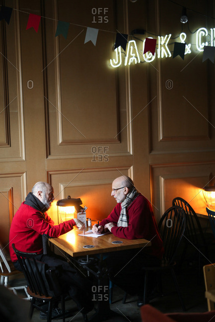 Saint Petersburg, Russia - January 27, 2015: Two men dining in restaurant