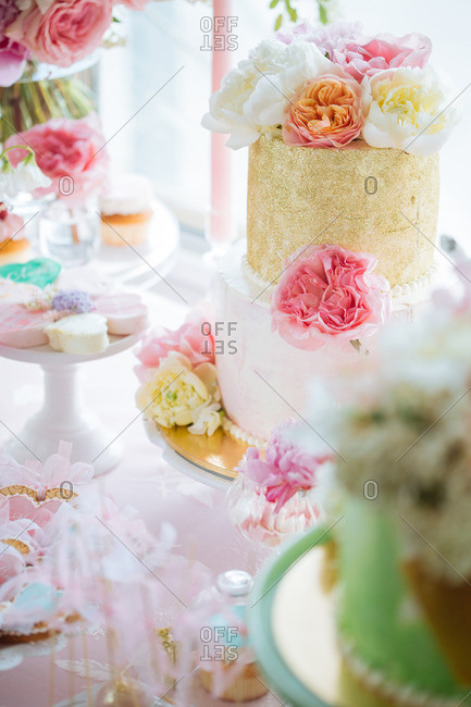 Cakes and flowers on dessert table