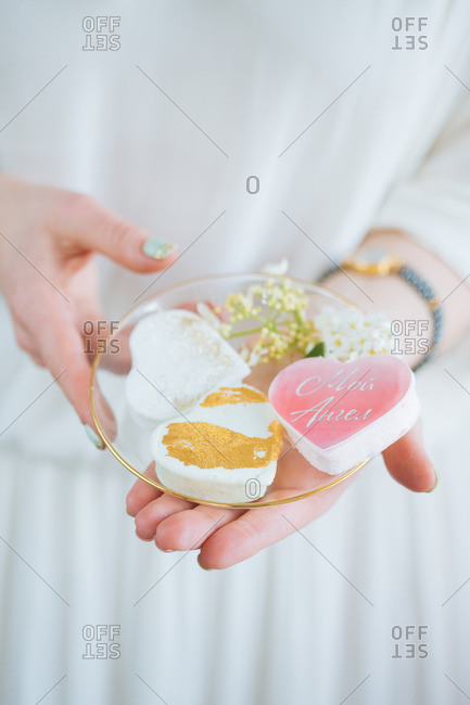 Woman with heart shaped desserts