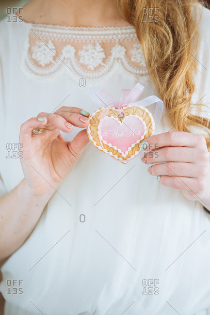 Woman holding a heart shaped cookie