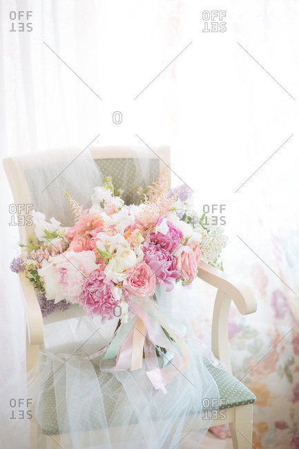 Flowers propped up on a chair